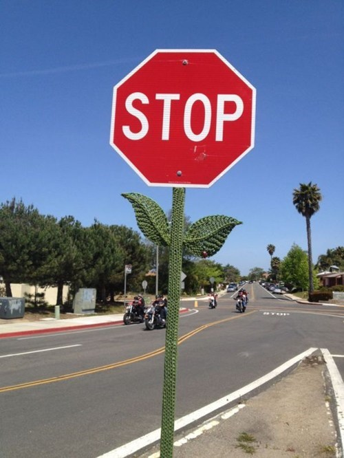 sign stop sign hacked irl yarn bombing