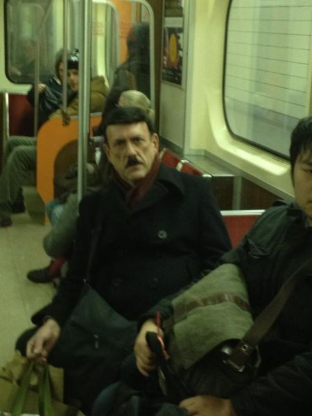 look alikes,adolf hitler,public transportation,poorly dressed,g rated