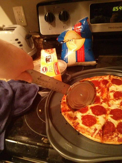 pizza cutter,ruler,pizza