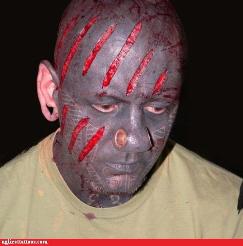 scarification face tattoos piercings - 7140730112
