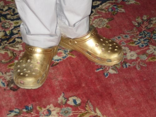 shoes gold crocs poorly dressed