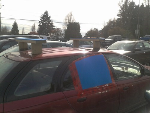 roof rack,windows,cars,wood,tape,there I fixed it