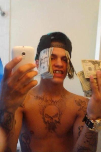 chest tattoos,money,skulls,selfie,Ugliest Tattoos