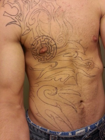 tribal tattoos,mazes,chest tattoos