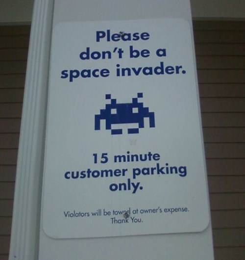 space invaders,IRL,signs,video games,parking