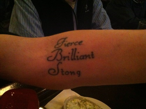 arm tattoos,misspelled tattoos,strong