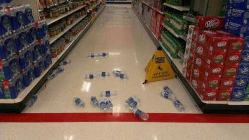 water,wet floor,aquafina,water bottles