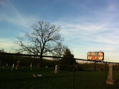 advertising,billboard,graveyard,irony,morbid
