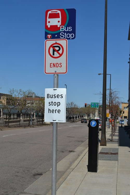 signs bus stop funny there I fixed it