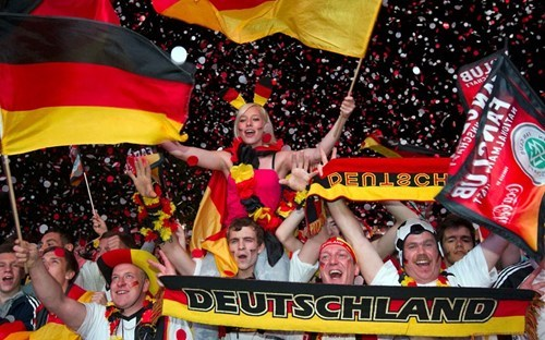 People waving flag and celebrating in Germany.