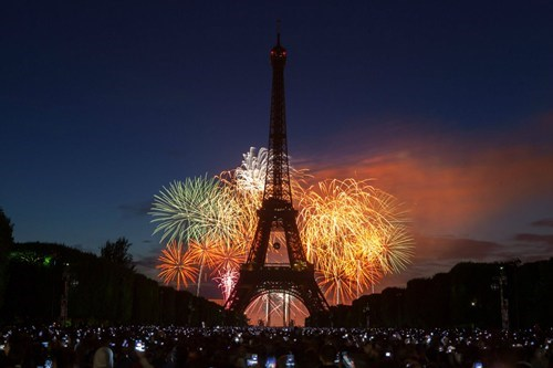 Classic France photo with Eiffel tower and fireworks in the background.