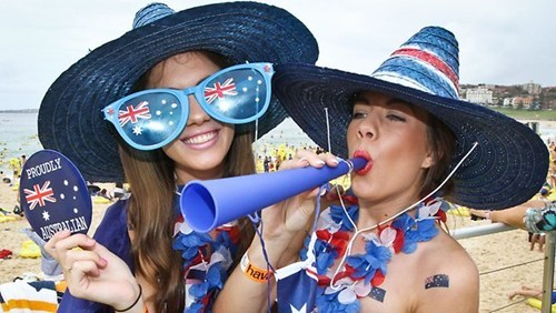 Australia - girls with hats and sports trumpet.
