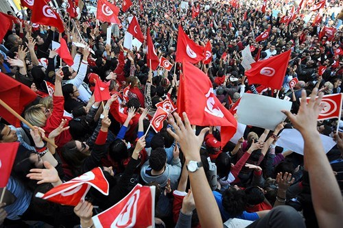 Tunisian crowd waving their red flags.