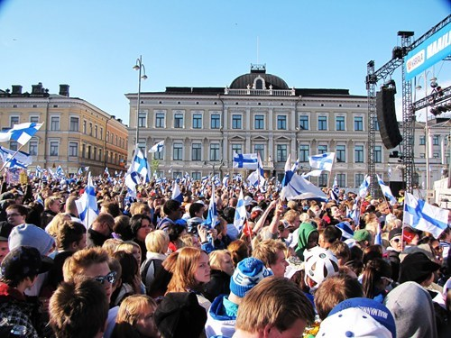 Finland crowds waving their blue and white flags.