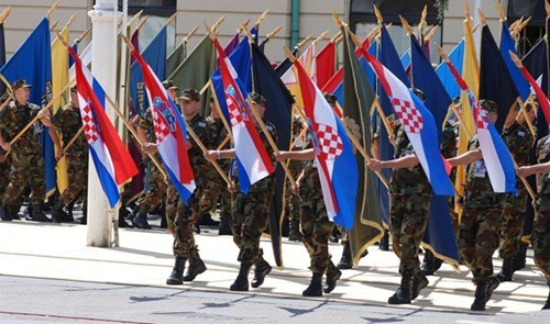 Soldiers marching with their flag in Croatia.