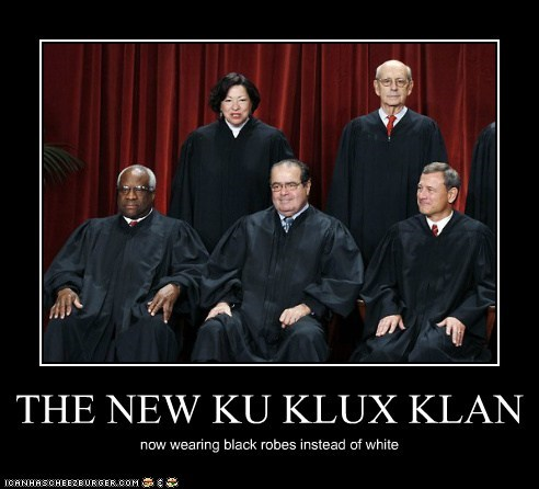 THE NEW KLAN now wearing black robes instead of white