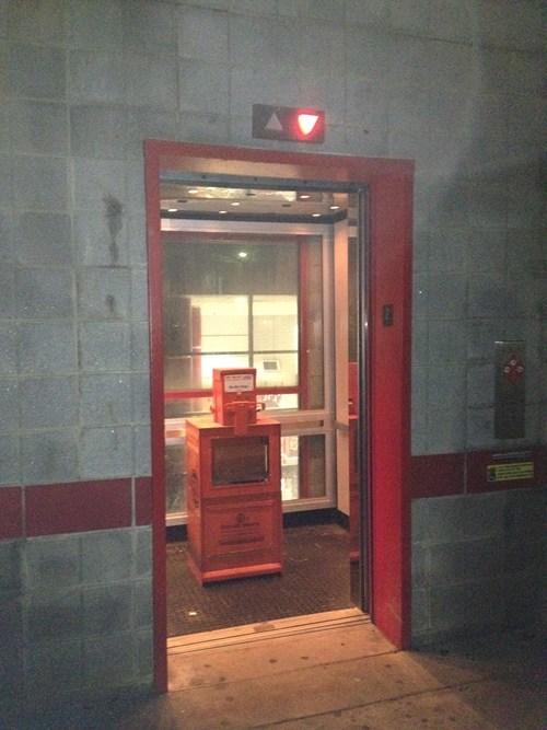 elevators wtf newspapers funny - 7648857600