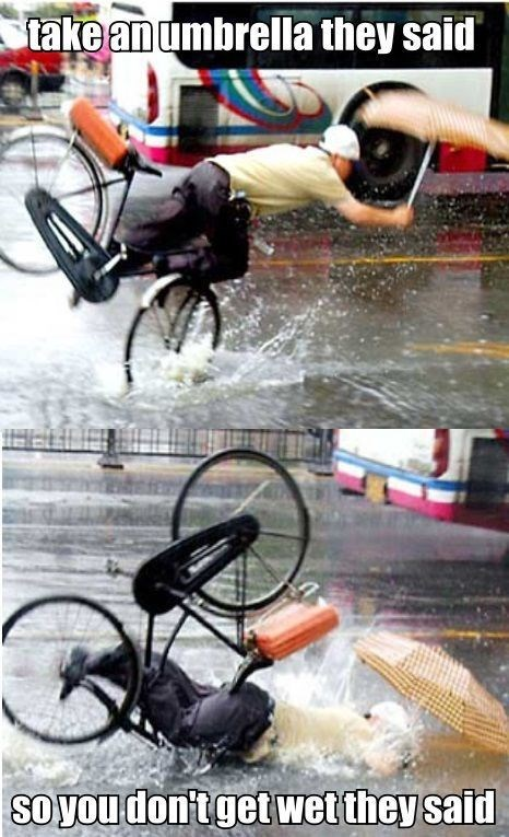 ouch,umbrella,bike,funny
