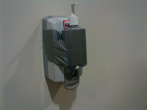 soap dispenser,duct tape,funny,there I fixed it