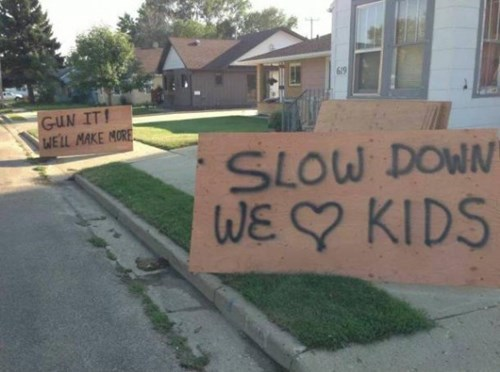 kids parenting road signs slow down children