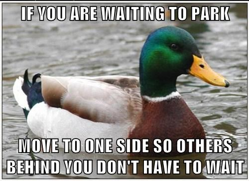 IF YOU ARE WAITING TO PARK  MOVE TO ONE SIDE SO OTHERS BEHIND YOU DON'T HAVE TO WAIT