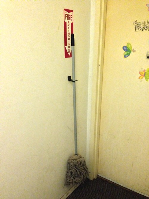 mop,fire extinguisher,there I fixed it