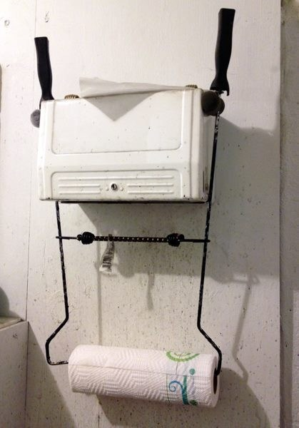 bungee cords,there I fixed it,paper towel holder