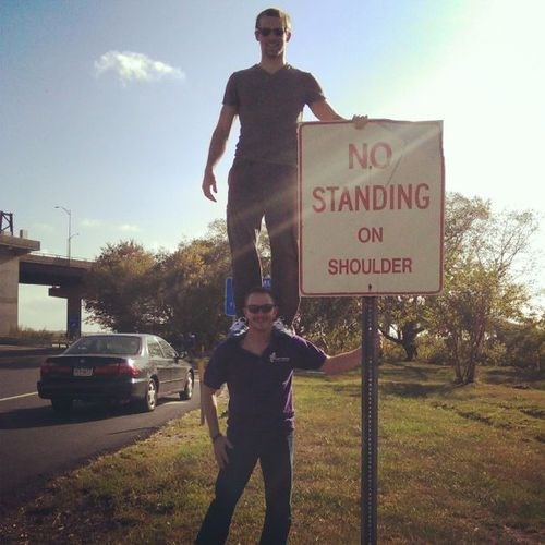 no standing on shoulder driving road signs we've got a badass over here