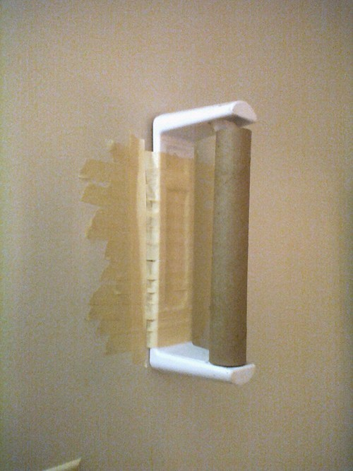 masking tape there I fixed it paper towel holder