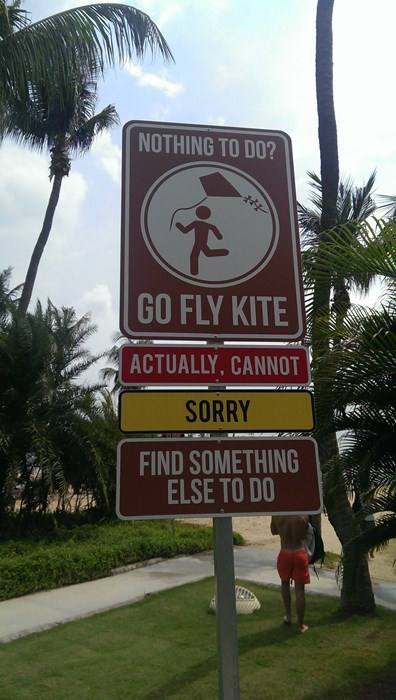 weird signs,kites,flying a kite,go fly a kite,singapore