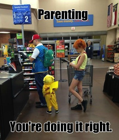 cosplay pokemon family waiting for checkout in a store dad dressed like ash ketchum and mom like misty and their young kid is in a pikachu onesie