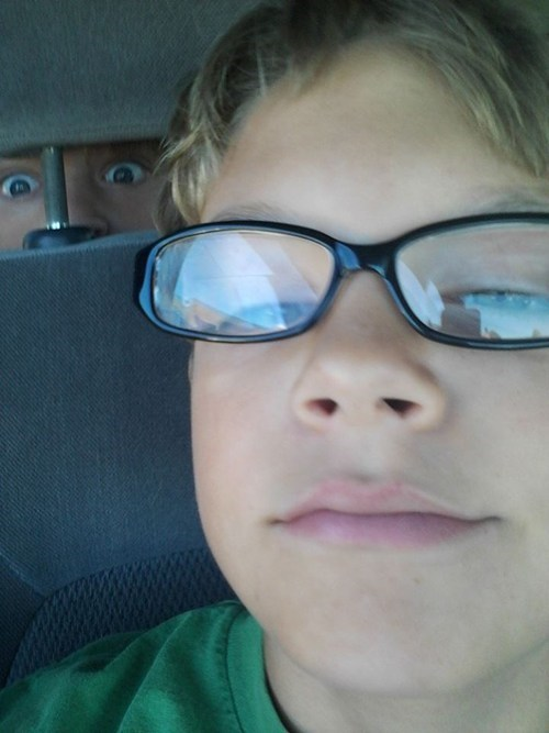 photobomb SOON sibling rivalry glasses brothers