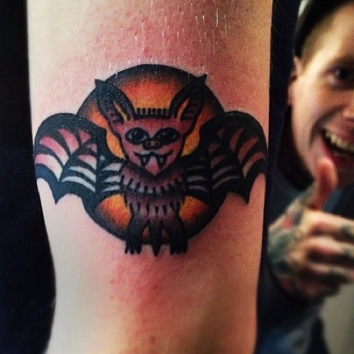 bats thumbs up tattoo photobomb
