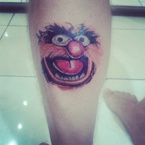animal,funny,legs,tattoos,muppets,g rated,Ugliest Tattoos