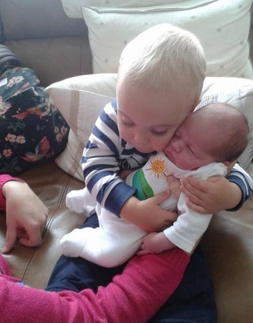 Babies parenting siblings - 7902740736