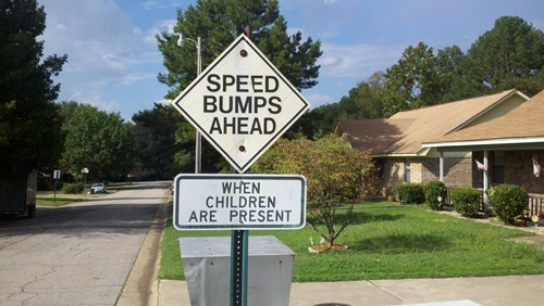 driving signs road signs speed bumps