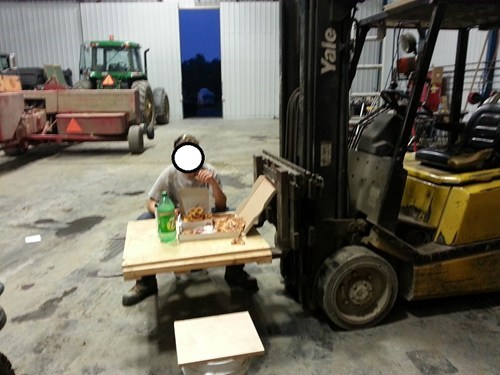 forklift,table,there I fixed it,pizza