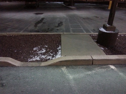 A wheelchair friendly sidewalk.