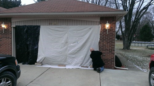 tarps garage there I fixed it