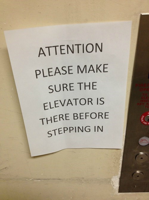 elevator,sign,warning