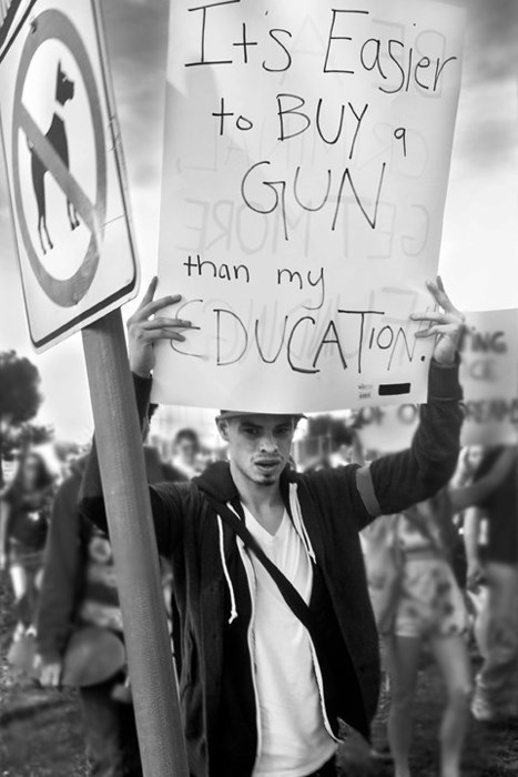 education,guns,signs