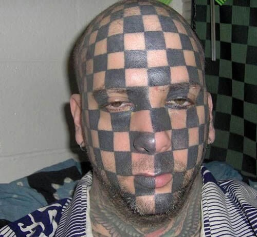 face tats checkerboard tattoos