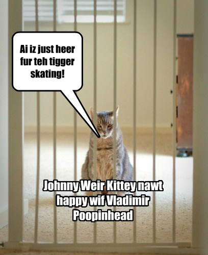 Johnny Weir Kittey nawt happy wif Vladimir Poopinhead Ai iz just heer fur teh tigger skating!
