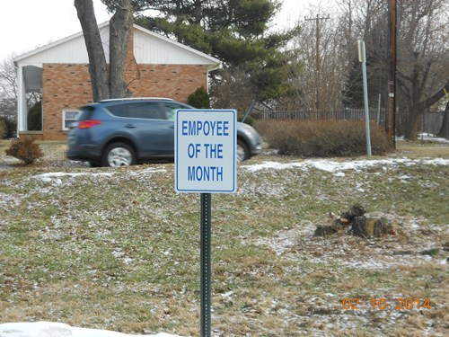employee of the month,monday thru friday,parking space,misspelling,sign,work