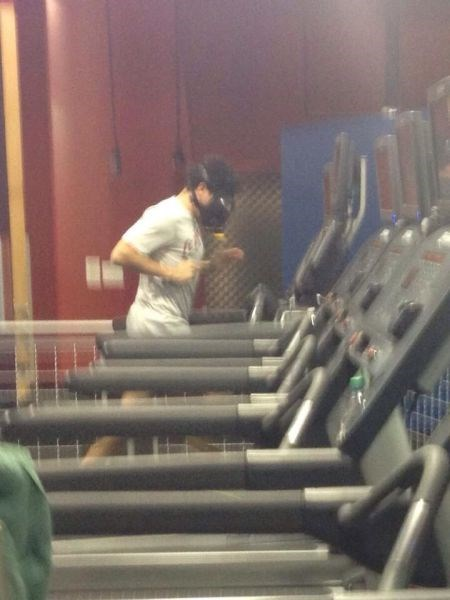 gym,poorly dressed,gas mask,working out