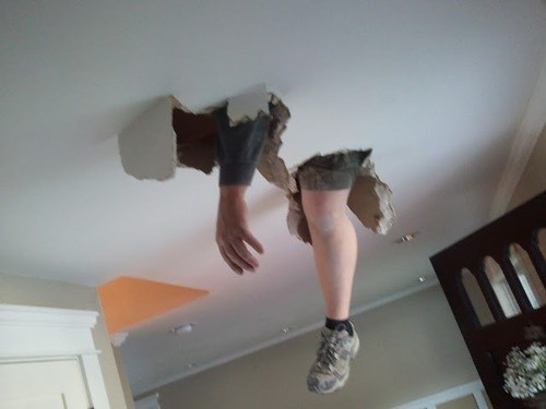 Kyle coming downstair from upstairs by punching thru the drywall