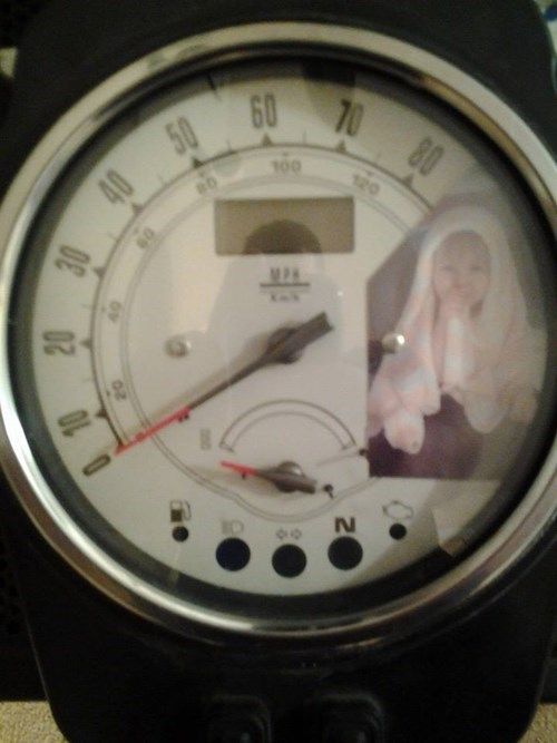parenting dad motorcycle daughter speedometer