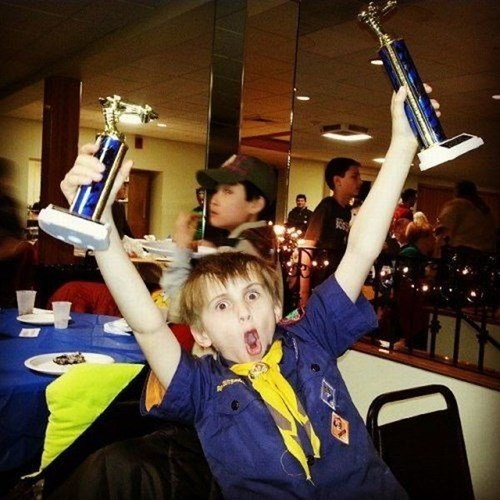 excited kids trophy parenting cub scouts