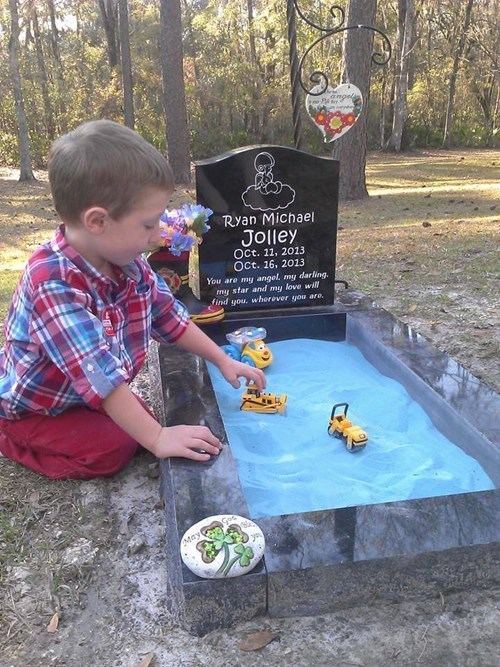 Sad sandbox kids brother parenting grave