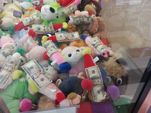 claw machine arcade game cash kids parenting